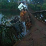 Trailer Carrying Excavator Causes Champassak Bridge Collapse