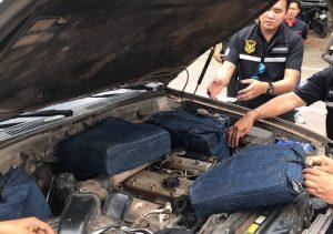Cash hidden under hood (bonnet) of vehicle