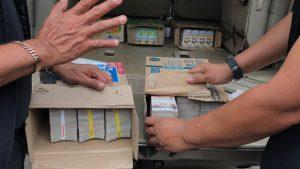 Cash hidden in milk cartons
