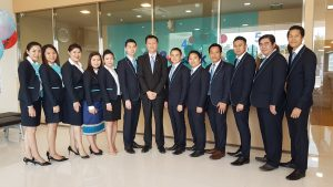 RHB Bank Lao staff pose at opening ceremony of Dongdok Branch