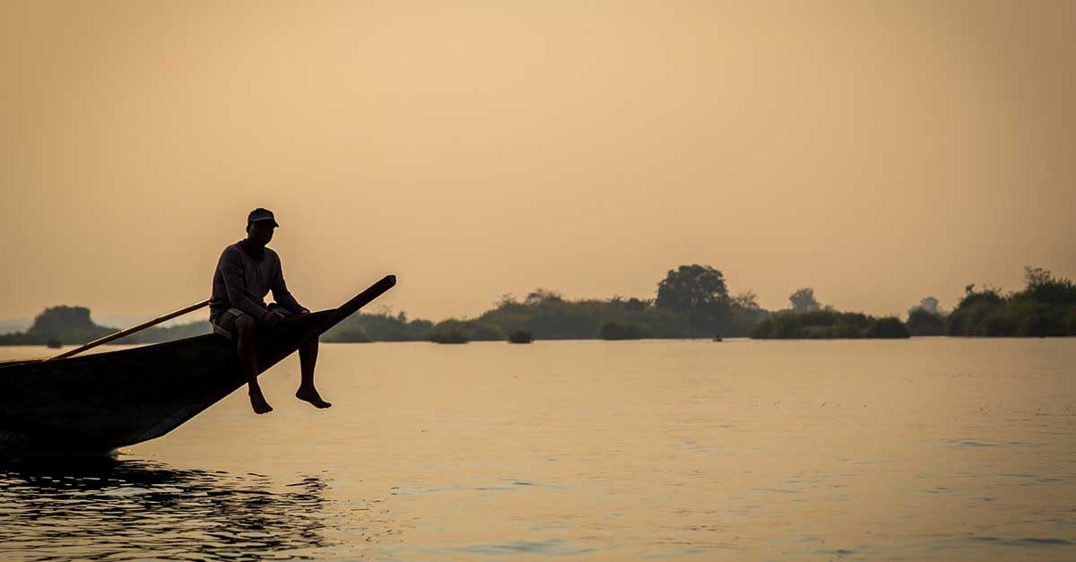 Person Riding a Boat in Don Det (Mekong River)