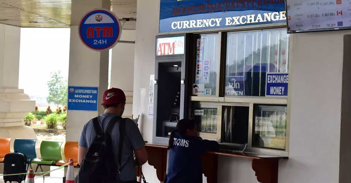 A tourist exchanges currency at a bank in Laos (Exchange Rates Photo: CareerGappers)