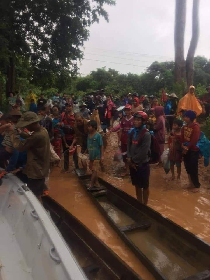 Villager being evacuated in Attapeu